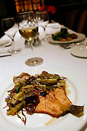 An entree of pan roasted trout with baby fennel confit, baby artichokes, roasted onions, and rosemary, at Absinthe Brasserie and Bar on Hayes Street in San Francisco, CA., on Tuesday, Oct. 23, 2007. ..PHOTOGRAPHER: Erin Lubin/Bloomberg News.