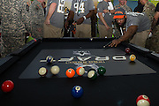 January 27 2016: Seattle Seahawks Michael Bennett plays pool during the Pro Bowl Draft at Wheeler Army Base on Oahu, HI. (Photo by Aric Becker/Icon Sportswire)