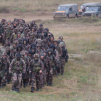 Soldiers line up after a joint Hungarian-US military exercise near Osku village (about 92 km South-West of capital city Budapest), Hungary on October 02, 2014. ATTILA VOLGYI
