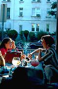 Women age 28 smoking in an outdoor Mexican restaurant.  Washington  DC USA