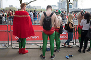 Supporters in superhero outfits encourage participants taking part in the London Marathon on 22nd April 2018 in London, England, United Kingdom. The London Marathon, presently known through sponsorship as the Virgin Money London Marathon, is a long-distance running event. The event was first run in 1981 and has been held in the spring of every year since. The race is mainly known for ebing a public race where ordinary people can challenge themsleves while raising great amounts of money for various charities.