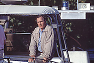 George Hubert Walker Bush talking to the press pool after a fishing trip on vacation at Isamorada, Florida in May 1990....Photograph by Dennis Brack BB19