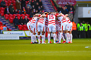 Doncaster Rovers players huddle during the EFL Sky Bet League 1 match between Doncaster Rovers and Coventry City at the Keepmoat Stadium, Doncaster, England on 4 May 2019.