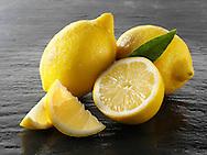 Fresh whole and cut lemons