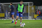 AFC Wimbledon striker Joe Pigott (39) and AFC Wimbledon defender Will Nightingale (5) warming up during the EFL Sky Bet League 1 match between AFC Wimbledon and Peterborough United at the Cherry Red Records Stadium, Kingston, England on 12 March 2019.