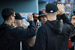 March 29, 2018 - Los Angeles, CA, U.S. - LOS ANGELES, CA - MARCH 29: San Francisco Giants Second base Joe Panik (12) celebrates with his team mates after hitting a solo home run during the MLB opening day game between the San Francisco Giants and the Los Angeles Dodgers on March 29, 2018 at Dodger Stadium in Los Angeles, CA. (Photo by Chris Williams/Icon Sportswire) (Credit Image: © Chris Williams/Icon SMI via ZUMA Press)