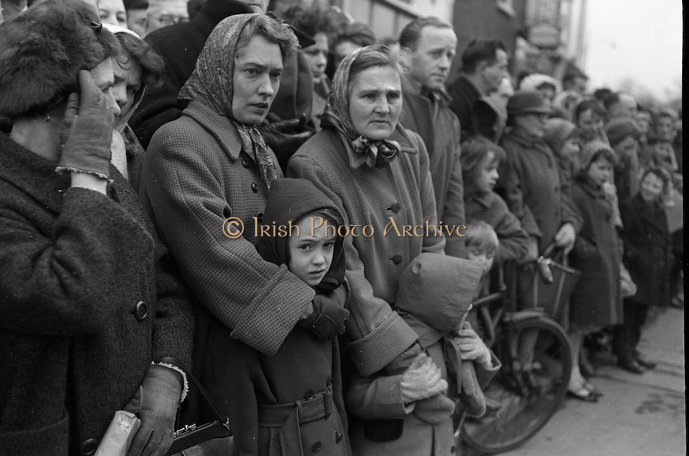 Some women in the crowd wipe their eyes as Cardinal D'Alton's funeral passed. The cardinal was buried in St Patrick's Cathedral, Armagh. .02.02.1963