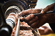 Detail of a woodworker's hands as he creates a wooden object on a lathe, Bac Ha District, Lao Cai Province, Northern Vietnam, Southeast Asia
