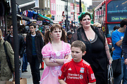 Mother Louise Irwin-Ryan with her daughter Georgia (11, wearing a pink Lolita dress) and son Kiefer (8, wearing a red Liverpool Football Club kit) spending a day out together in Camden Town, North London. Louise is on various benefits to help support her family income, and housing, although recent government changes to benefits may affect her family drastically, possibly meaning they may have to move out of London. Louise Ryan was born on the Wirral peninsula in 1970.  She moved to London with her family in 1980.  Having lived in both Manchester and Ireland, she now lives permanently in North London with her husband and two children. Through the years Louise has battled to recover from a serious motorcycle accident in 1992 and has recently been diagnosed with Bipolar Affective Disorder. (Photo by Mike Kemp/For The Washington Post)
