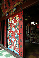 Quan Cong Temple is a good example of a Chinese temple with lots of red and gold ornamentation and a carp-filled pond in the opened portion of the inner courtyard. Its bas-relief doorway is only one of the treasures inside.