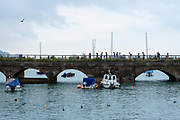 People walking across the Folkestone Harbour viaduct on the 25th of July 2021 in Folkestone, United Kingdom. The viaduct is a former train track that has been converted to a pedestrian walkway, it connects the north side of the harbour with Folkestone Harbour Arm. (photo by Andrew Aitchison / In pictures via Getty Images)
