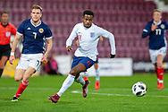 Chris Cadden (#7) of Scotland U21s (Motherwell FC) and Ryan Sessegnon (#11) of England U21s (Fulham) during the U21 UEFA EUROPEAN CHAMPIONSHIPS match between Scotland and England at Tynecastle Stadium, Edinburgh, Scotland on 16 October 2018.