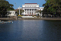 """Negros Occidental Capital Building governing this province of the Philippines.  The capital is Bacolod. Negros and occupies the half of Negros Island and is known as """"Sugarland"""" as it supplies much of the Philippines and the world's sugar.  Negros Occidental Capitol Park and Lagoon is a provincial park in the center of Bacolod.  A unique feature of the park are sculptures of a woman standing alongside a water buffalo and a man pulling another water buffalo. These sculptures are placed at ends of the lagoon. They were executed by Italian sculpture Francesco Riccardo Monti."""