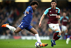 Chelsea's Willian (left) and West Ham United's Aaron Cresswell battle for the ball during the Premier League match at Stamford Bridge, London.