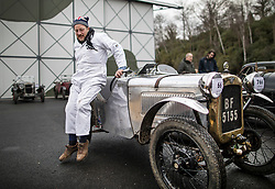 © Licensed to London News Pictures. 28/01/2018. Weybridge, UK. Driver Olly Sanders leaps from a 1929 Austin 7 Ulster at Brooklands Museum after taking part in The Vintage Sports-Car Club's New Year driving tests round the historic motor racing circuit. Photo credit: Peter Macdiarmid/LNP