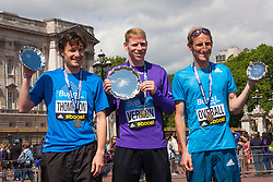 London, May 25th 2014.Bupa London 10,000 podium with , left to right, runner-up Chris Thompson, winner Andy Veron and third placed Scott Overall.