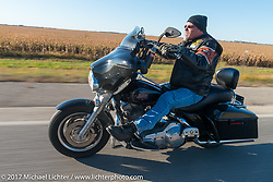 Mike Lenling of the Old Cronies in Aberdeen SD riding his Harley-Davidson Electra Glide Standard in the USS South Dakota submarine flag relay across South Dakota. Groton, SD. USA. Sunday October 8, 2017. Photography ©2017 Michael Lichter.