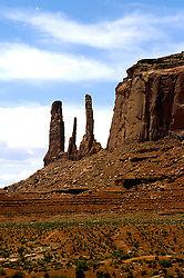 AZ, Monument Valley, Three Sisters and Merrick Rock Mesa  .Photo Copyright: Lee Foster, lee@fostertravel.com, www.fostertravel.com, (510) 549-2202.Image: azmonu206