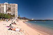 People sunbathing on Waikiki Beach.