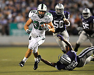 MANHATTAN, KS - AUGUST 30:  MANHATTAN, KS - August 30:  Running back Micah Mosley #32 of the North Texas Mean Green rushes up field for a first down past free safety Chris Carney #30 of the Kansas State Wildcats in the third quarter on August 30, 2008 at Bill Snyder Family Stadium in Manhattan, Kansas.