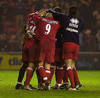 Photo. Glyn Thomas.<br /> Middlesbrough v Everton. Carling Cup Round 4.<br /> Riverside Stadium, Middlesbrough. 03/12/2003.<br /> Boro players mob Mendieta after he scored the winning penalty.