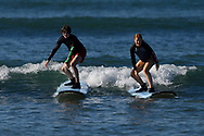 Mimmi Widstrand and Oskar Sunding, on a surf board, Maui, Hawaii.