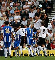 Photo: Steve Bond.<br />Derby County v RCD Espanyol. Pre Season Friendly. 04/08/2007. Gorka Iraizoz punches clear under pressure from Steve Howard