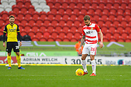 James Coppinger of Doncaster Rovers (26) gets the game underway during the EFL Sky Bet League 1 match between Doncaster Rovers and Scunthorpe United at the Keepmoat Stadium, Doncaster, England on 15 December 2018.