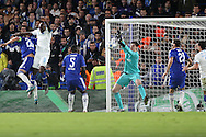 Goalkeeper Thibaut Courtois of Chelsea makes a close range save from a header by Bruno Martins Indi of FC Porto. UEFA Champions league group G match, Chelsea v Porto at Stamford Bridge in London on Wednesday 9th December 2015.<br /> pic by John Patrick Fletcher, Andrew Orchard sports photography.