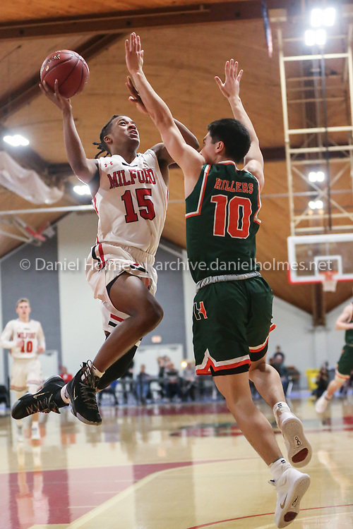 Milford's Jordan Darling flies for two points during the Division 2 Central semifinals against Hopkinton at Clark University, on Mar. 3, 2020.