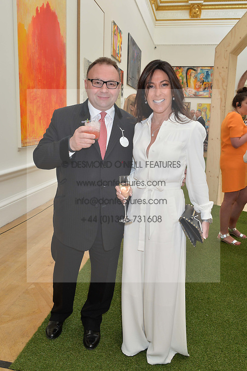 JONATHAN SHALIT and his wife KATRINA SHALIT at the annual Royal Academy of Art Summer Party held at Burlington House, Piccadilly, London on 4th June 2014.