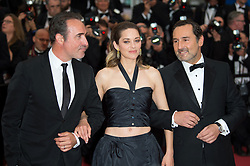 Gilles Lellouche, Marion Cotillard and Jean Dujardin arriving on the red carpet of 'La Belle Epoque' screening held at the Palais Des Festivals in Cannes, France on May 20, 2019 as part of the 72th Cannes Film Festival. Photo by Nicolas Genin/ABACAPRESS.COM