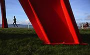 Runners and readers enjoy the Seattle Art Museum's Olympic Sculpture Park. (Ken Lambert / The Seattle Times)