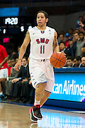 DALLAS, TX - JANUARY 15: Nic Moore #11 of the SMU Mustangs brings the ball up court against the South Florida Bulls on January 15, 2014 at Moody Coliseum in Dallas, Texas.  (Photo by Cooper Neill/Getty Images) *** Local Caption *** Nic Moore