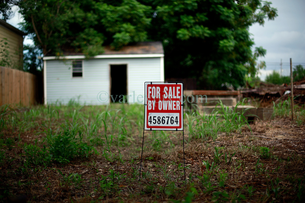 27 August 2014. Lower 9th Ward, New Orleans, Louisiana.<br /> Hurricane Katrina 9 years later. Land for sale. Many derelict, falling down buildings dot the landscape as the area struggles to recover from Hurricane Katrina.<br /> Photo; Charlie Varley/varleypix.com