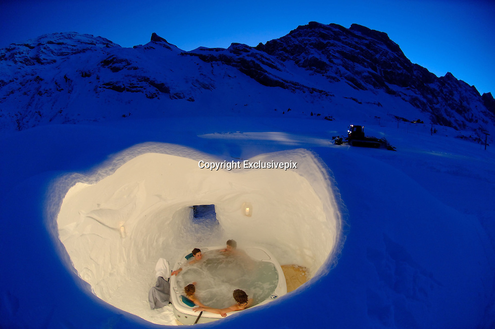 Check in, chill out! Stunning igloo hotel opens with private pools, mountain saunas and candle-lit suites ... but no running water<br /> <br /> Every winter, this hotel is carved out of the surrounding snow, with igloo rooms, romantic suites and even an outdoor whirlpool for the bravest guests.<br /> <br /> Iglu-Dorf hotel is rebuilt every season from 3,000 tons of snow at six locations from the Alps to the Pyrenees.<br /> <br /> The Swiss igloos, constructed in the Bernese Oberland and surrounded by 9,000ft mountain peaks, comes with artworks carved into the walls by artists from around the world, candle-lit suites for romantic guests and even saunas among the mountains.<br /> Open from Christmas Day to April, each villages sleeps up to 38 guests, cocooning them in cosy sleeping bags on thick sheepskin rugs, designed to withstand temperatures of minus 40C.<br /> <br /> And in the morning, there's an enormous buffet of croissants, cooked meats, pastries, cereals, cheese and coffee.<br /> <br /> The cost for one in a standard Iglu-Dorf igloo is 99euros (£68) from Monday to Thursday and 115 euros from Friday to Sunday.<br /> <br /> A tour around the Gstaad site shows the great diversity of works in rooms and common areas of the unique accommodation from traditional Inuit works to artists from Switzerland and much further abroad.  <br /> <br /> Artists armed with no more than an ice pick, motorised saw and shovel, produce life-like animals such as seals, arctic wolves, polar bears and whales, eye-catching designs and patterns, or even super heroes. <br /> <br /> It's an elaborate and classy scene compared to the basic igloo Gunter first constructed with friends on a mountain in a bid to be first on the slopes in the morning.  <br /> <br /> The company says 99 per cent of their guests stay one night only. <br /> <br /> 'We don't generally recommend [more than one night] as we neither have running water, nor showers,' the company says.  <br /> <br /> Each village caters 