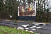 Rusting billboard showing a faded advert landscape at the Reading Services on the M4 motorway. This rural landscape shows us the state of old advertising in this location at this rest-stop on one of Britain's main motorways running from east/west: between London and Wales. Its rusting surface shows older ad campaigns visible to passing traffic after leaving the motorway.