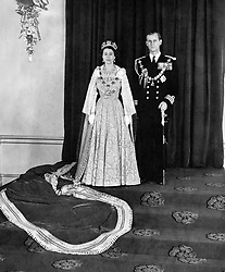 File photo dated 04/11/52 of Queen Elizabeth II and Duke of Edinburgh in the Throne Room of Buckingham Palace, after they returned from the Queen's first State Opening of Parliament. The Royal couple will celebrate their platinum wedding anniversary on November 20.