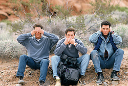 Friends signing see no evil, speak no evil, hear no evil