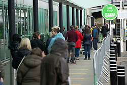 Hamilton, Scotland, UK. 1 April, 2020. Long queue of shoppers at Asda in Hamilton maintaining recommended coronavirus social distancing. Iain Masterton/Alamy Live News