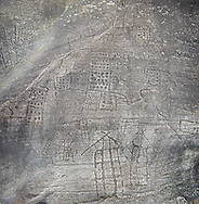 Prehistoric Petroglyph, rock carving, of what is known as the Map of Bebolina with depictions of huts raised on wooden poles and field systems carved by the Camunni people in the iron age between 1000-1600 BC, Rock no 1 , Seradina-Bedolina Archaeological Park, Valle Comenica, Lombardy, Italy .<br /> <br /> Visit our PREHISTORY PHOTO COLLECTIONS for more   photos  to download or buy as prints https://funkystock.photoshelter.com/gallery-collection/Prehistoric-Neolithic-Sites-Art-Artefacts-Pictures-Photos/C0000tfxw63zrUT4<br /> If you prefer to buy from our ALAMY PHOTO LIBRARY  Collection visit : https://www.alamy.com/portfolio/paul-williams-funkystock/valcamonica-rock-art.html