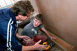 BEECAN Housing Project; Leeds; UK, Volunteer helps teenage boy to learn woodworking skills 3 days a week instead of going to school, Scheme restores derelict houses for refugees to live in and provides training for teenage boys,