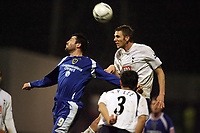 Photo: Rich Eaton.<br /> <br /> Cardiff City v Tottenham Hotspur. The FA Cup. 07/01/2007. Steve Thompson left of Cardiff jumps with Calum Davenport of Spurs