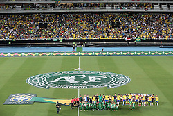 RIO DE JANEIRO, Jan. 26, 2017  Players of both teams and the suviors of the airplane crash in Colombia pose for group photos before a friendly match between Brazil and Colombia at the Engenhao Stadium in Rio de Janeiro, Brazil, on Jan. 25, 2017. All the net income of the match will be passed on to the Chapecoense Football Association. (Credit Image: © Li Ming/Xinhua via ZUMA Wire)