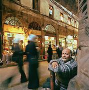 A man sits in the Al-Hamidiyah Souq in Damascus, Syria