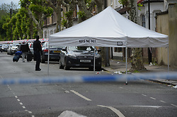 © Licensed to London News Pictures. 28/05/2019. London UK: Police and Forensic officers at the scene of a fatal stabbing in Newham, east London. Police were called to Warwick road in east London in the early hours of this morning where a male in his thirties was found with stab wounds and later died of his injuries in hospital  , Photo credit: Steve Poston/LNP