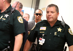 Golfer Tiger Woods makes his way into a North County Courthouse courtroom in Palm Beach Gardens, FL, USA, Friday Oct. 27, 2017 to plead guilty to a second-degree misdemeanor reckless driving charge. Photo by Carline Jean/Sun Sentinel/TNS/ABACAPRESS.COM