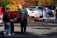 SOUTHINGTON, CT - 02 NOVEMBER 2010 -.State Senate candidate Joe Markley of the Tea Party greets Jacob Lasek, 5, and his sister Emily, 8, of Newington as they accompany their grandmohter Millie Gagnon of Southington to vote at John F. Kennedy Middle School in Southington on Tuesday. Markley is running against Democrat John Barry..Photo by Josalee Thrift