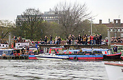 Putney. London.  2004 University Boat Race,  Championships Course, Putney to Mortlake. <br /> Spectators watch the  Cambridge and Oxford, race from the the mooring at Furnival  Garden Hammersmith .  <br /> <br /> [Mandatory Credit Peter SPURRIER]