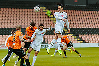 Football - 2020 / 2021 Emirates FA Cup - Round 2 - Barnet vs Milton Keynes Dons - The Hive<br /> <br /> George Williams (MK Dons) rises to flick a header towards the Barnet goal <br /> <br /> COLORSPORT/DANIEL BEARHAM